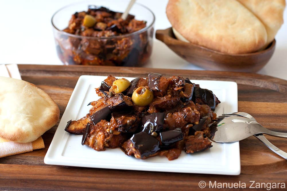 Caponata is a Sicilian eggplant dish consisting of a cooked vegetable ...