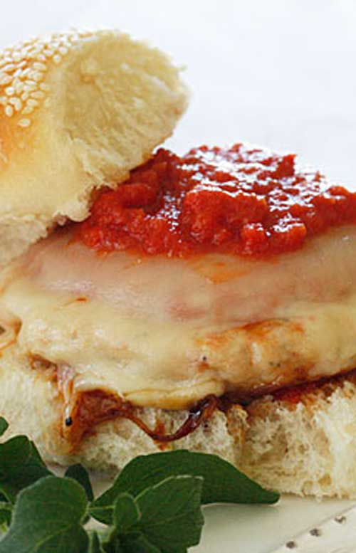 TheseChicken Parmigiana Burgers are a quick lunch or weeknight meal ready in less than 10 minutes your whole family will enjoy!