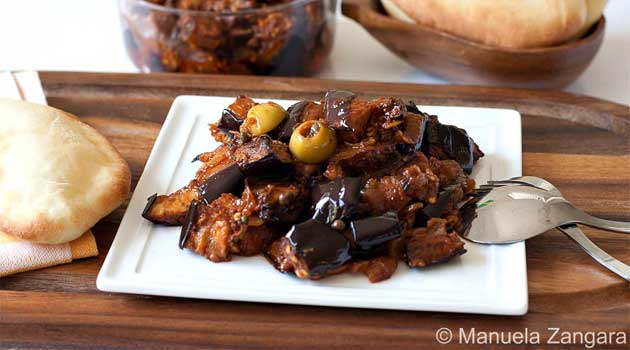 Caponata is a Sicilian eggplant dish consisting of a cooked vegetable salad made from chopped fried eggplant and celery seasoned with sweetened vinegar, with capers in a sweet and sour sauce.