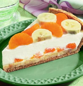 Bananas and mandarin oranges are beautifully arranged in this light and creamy tropical pie.