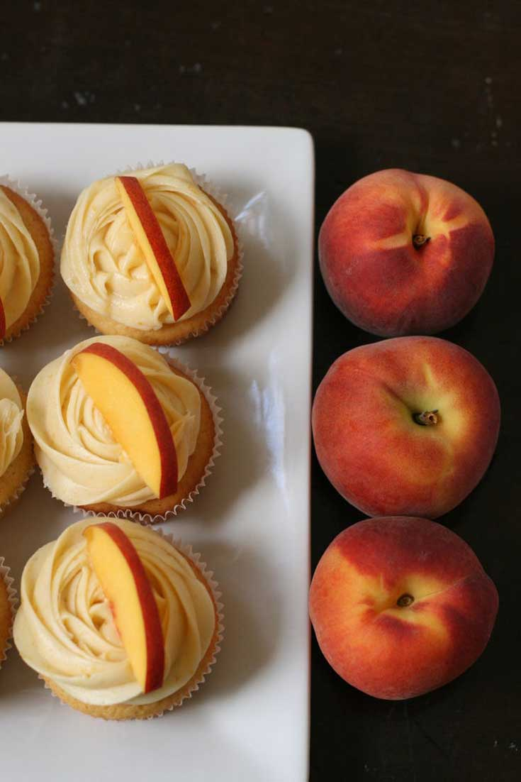 This recipe makes perfect peach cupcakes topped with a light, fresh peach cream cheese frosting. The perfect dessert for summer!