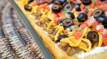 ThisEasy Taco Pizza is a great alternative to tacos (which our family loves!). I'm always looking for new Mexican dishes because we love them so much. This is so easy and something everyone in the family will love.
