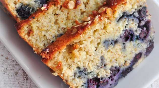This Lemon Blueberry Oatmeal Bread is really moist with oodles of succulent blueberries in it and the texture is sort of a hybrid between that of a cake and a bread.