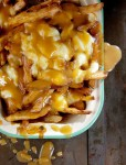 Recipe for Poutine – French Fries with Gravy and Cheese Curds – An unabashedly savory collage of french-fried potatoes, beef gravy, and squeaky-fresh cheese curds, poutine is perhaps the ultimate late-night snack.