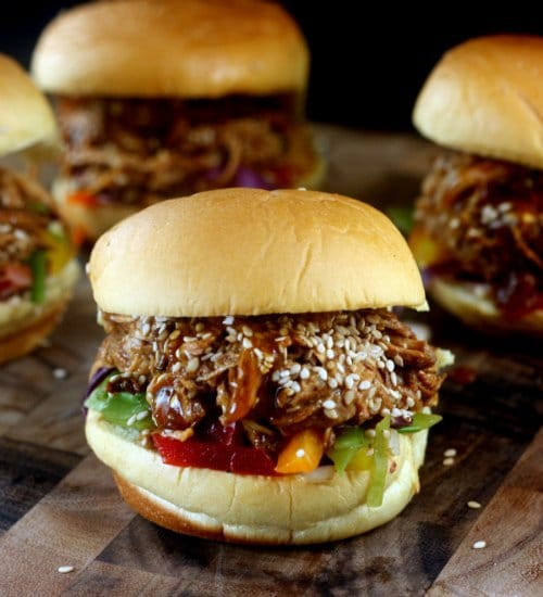 Pulled Honey Sesame Chicken Sandwiches with Rainbow Slaw