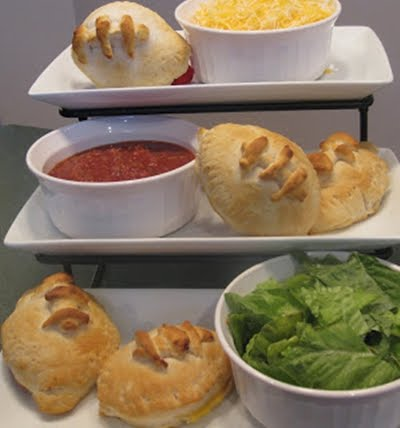 When feeding a crowd, I look for three things: Cheap, Easy, and Delicious. I created these fun pockets that are a snap to whip up for any football game. Enjoy!
