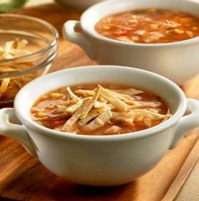 Leftover turkey is easily transformed into this satisfying, Hearty Turkey Tortilla Soup with just the right amount of spice! Ready in just 50 minutes, it's simply delish!