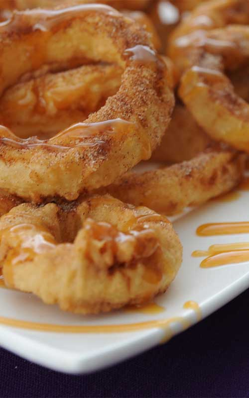 These crispy apple rings are warm and comforting on a cool fall day – and such a unique dessert! I love these sprinkled with cinnamon sugar and then drizzled with syrup.