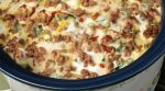 Breakfast Casserole filled with sausage, potatoes, eggs and cheese – all your favorites. This is a wonderful recipe that can cook all night while you sleep. Wake up, make the coffee, and breakfast is ready.