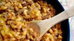 This tasty cheesy chili mac is so good your belly will say oh thank you, thank you (so will your family!). This one pan meal is ready in under an hour and there's almost no clean up.
