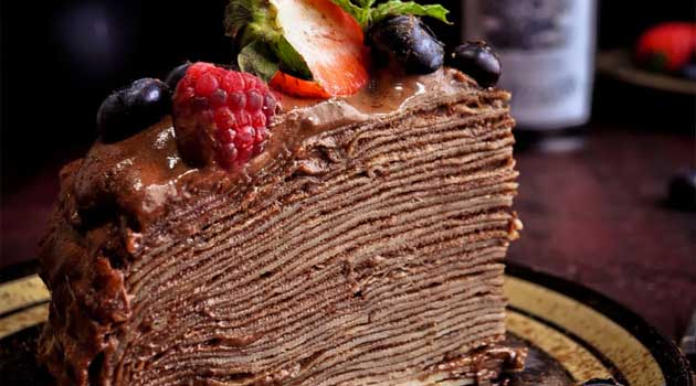 The best thing about this Crepe Cake is that it is not very heavy and rich, unlike the traditional birthday cakes that areloaded with buttercream, and neither is it overwhelmingly sweet. I loaded it with berries hoping that it would give it a nice touch!!