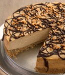 Rich, thick, and silky – this Chocolate Drizzled Peanut Butter Cheesecake is packed with peanut butterflavor.