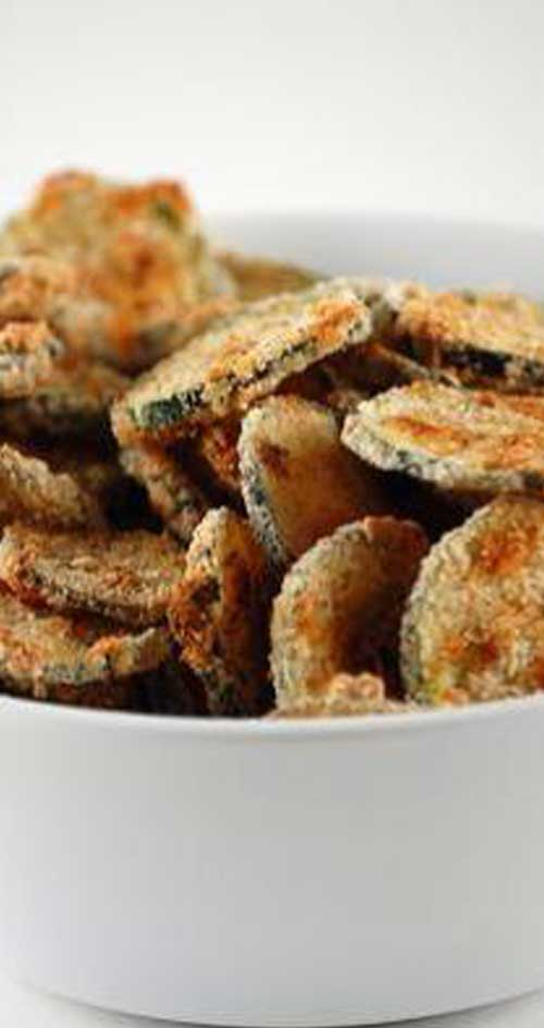 Baked Zucchini Chips - Ditch the potato chips and reach for these healthier baked zucchini chips instead! They'll still satisfy that salty and crunchy flavor, but without all the added fat and calories