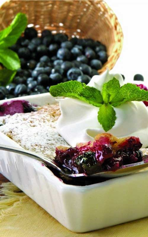 Blueberry Cobbler Recipe - Blueberry Cobbler has a layer of fresh blueberries covered in a cake-like cobbler topping. Serve with a scoop of ice cream for a delicious summer dessert.