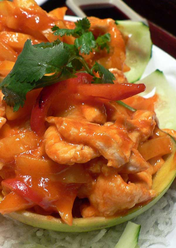 Recipe for Asian Mango Chicken - Bring Hawaii to your plate with this dish of chicken smothered in a rich mango sauce.