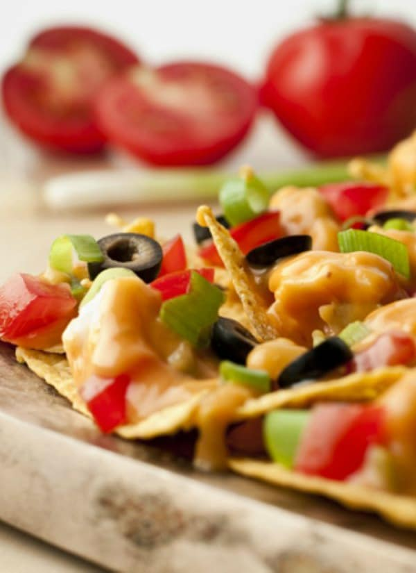 Recipe for Chicken Nachos - Got the munchies? Here's a solution...cheesy chicken nachos that use canned chicken and prepared picante sauce so they're ready in just 15 minutes.