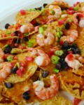 The easiest way to get the family together for a meal is with a delicious, homemade dish with tasty ingredients, such as the one's in these Quick-and-Easy Cheesy Gulf Shrimp Nachos.