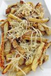 This recipe for Garlic Cheese Fries is a stunning little mountain of cheesy, garlicky, crispy French fried goodness that you will be making time and time again!