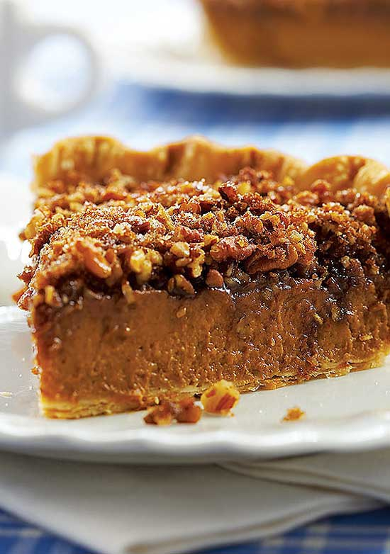 Praline Pumpkin Pie - A great choice when you can't decide whether to make pumpkin or pecan pie! I adore this pie. I think the praline layer adds a lovely new dimension to a plain ole pumpkin pie.